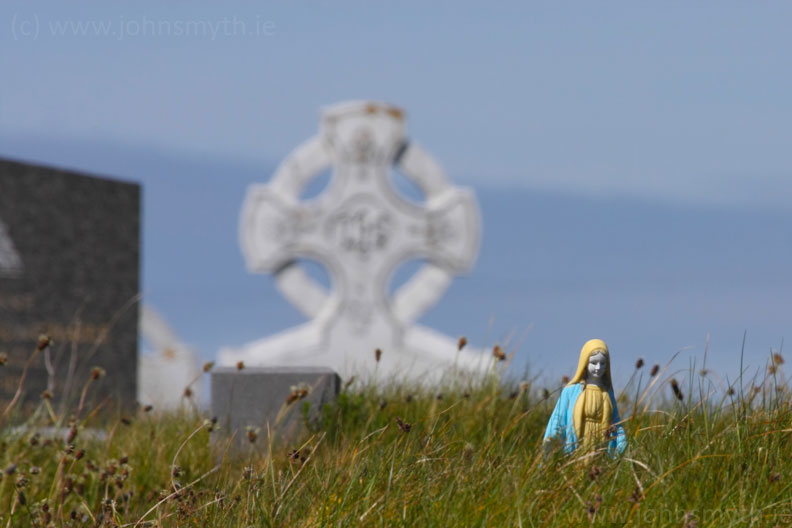 Statue of the Virgin Mary in a graveyard on Inish Meain